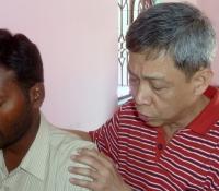 Pastor Chee Kong Praying at Bible School